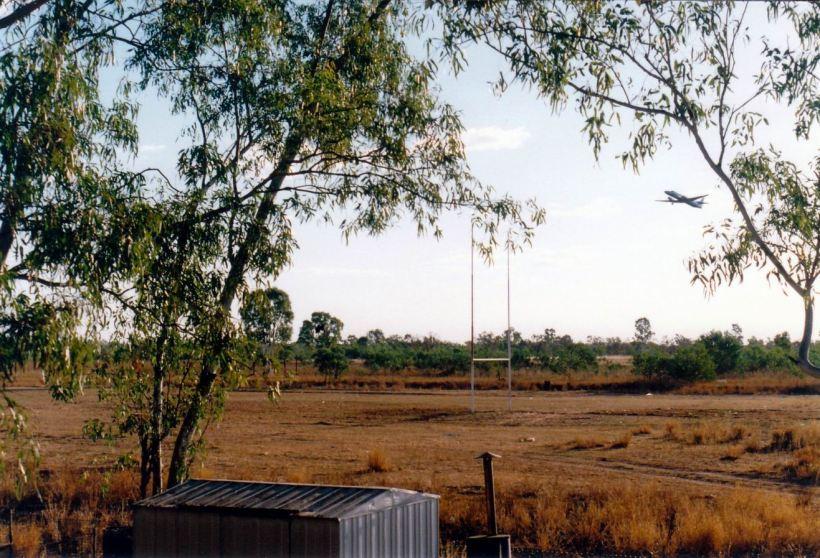 Resize of 08-28-2002 plane leaving as seen from back veranda doom.jpg