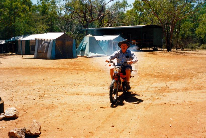 Resize of 08-07-2003 07 John on bike in camp area.jpg