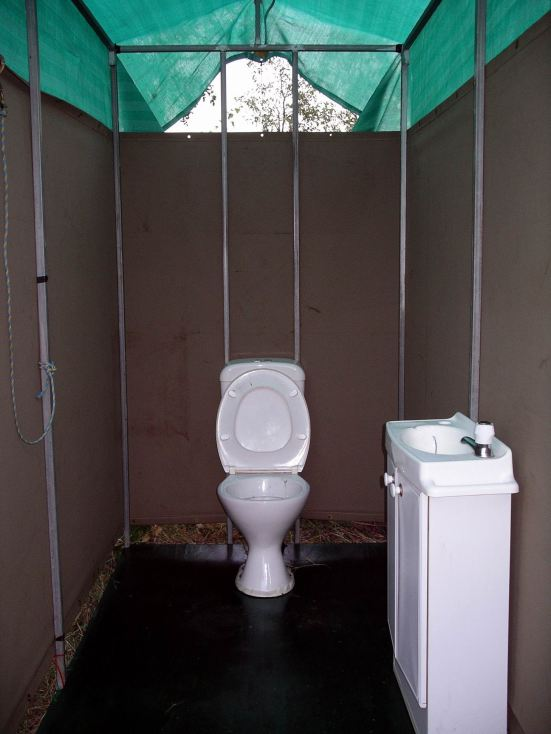 Resize of 04-18-2005 03 Flushing Camp Toilet!.JPG